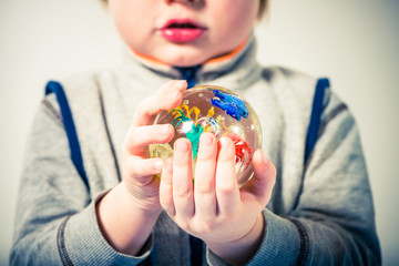abstract colorful glass ball in boy hands