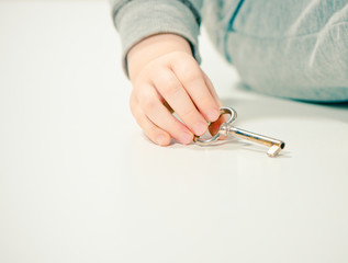 boy holding old key in hand