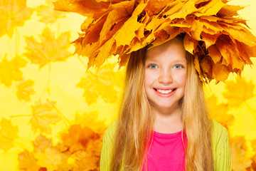 Beauty portrait of blond girl in maple wreath