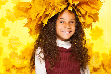 Beauty portrait of black girl in maple wreath