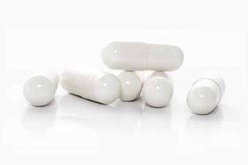 closeup white medicine capsules