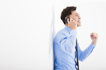 successful businessman talking on the phone in office