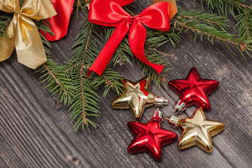 Christmas decoration on wood background, red and golden stars