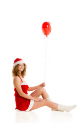 Santa girl sitting with red balloon vertical