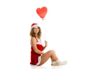 Santa girl sitting with heart shaped balloon horizontal