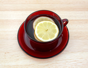 Cup of tea with lemon slices on a wood counter top