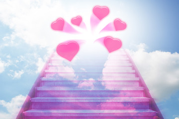 stairway going up to the hearts with blue sky background