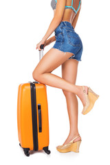 Elegant woman holding suitcase