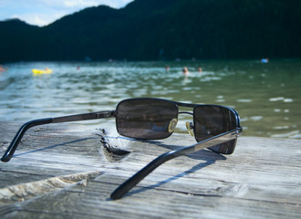 sunglasses by the lake