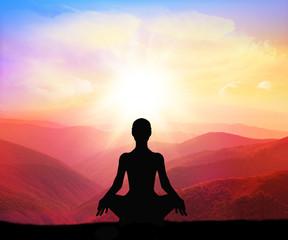 Yoga practicioner during the sunset meditation