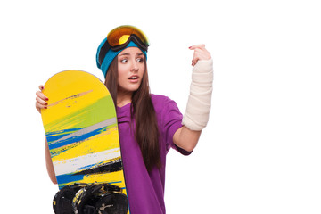 Scared woman with broken arm and snowboard