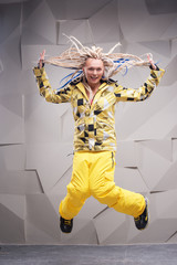 Young woman with dreadlocks jumping