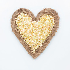 Frame in the shape of heart with millet