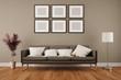 Leinwanddruck Bild - Wand mit Bilderrahmen im Wohnzimmer