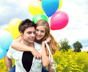 Happiness: Young couple with colorful balloons :)