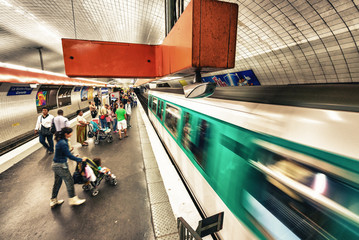 PARIS - MAY 23, 2014: Paris Metro station with fast moving train