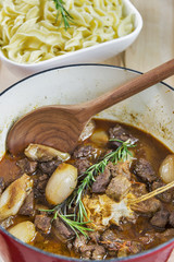 Greek beef stifado served with egg noodles