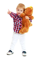 Little boy hugging a teddy bear.