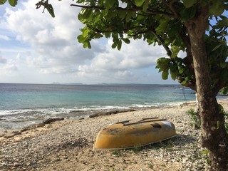 bonaire beach with little boat