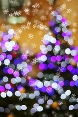 Defocused abstract light bokeh on christmas tree