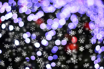 Defocused abstract light bokeh and snow flakes falling for chris