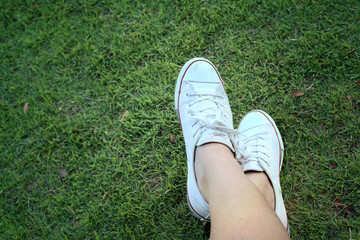 White shoes on a green grass background.