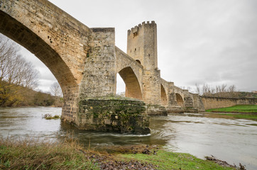 Ancient medieval bridge on a cloudy day in Frias, Burgos, Spain.