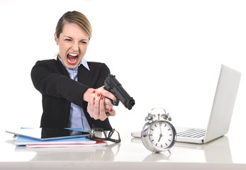 furious businesswoman pointing gun to alarm clock