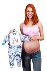 Happy pregnant woman, holding boy's dress