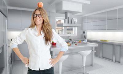 Woman with apple in the kitchen