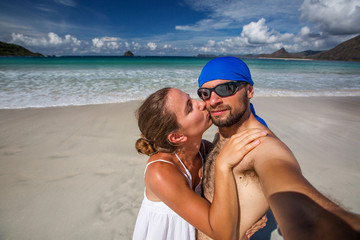 Man and woman have fun at the beach of island in Indian ocean