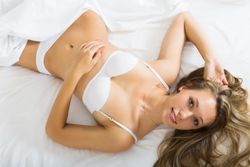 Sexy woman    laying on bed