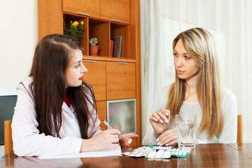 doctor prescribing medication to  woman