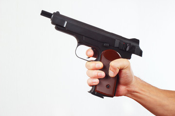 Hand with discharged gun on a white background