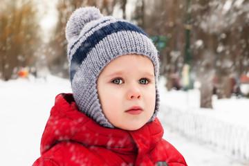 Portrait of little boy in winter park