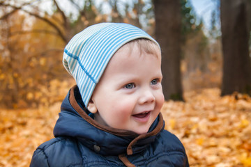 Cute kid outdoors in autumn