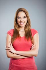 Portrait of confident young woman smiling. Studio shot.