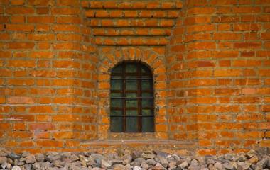 Old brick wall with window closeup