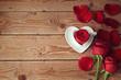 Obrazy na płótnie, fototapety, zdjęcia, fotoobrazy drukowane : Roses and flower petals on wooden background, Valentine's day