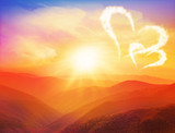 Majestic sunset in the mountains  with hearts and Valentines day