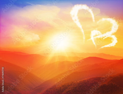 Majestic sunset in the mountains with hearts and Valentines day © Belight