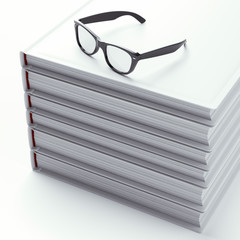 Stack of books with black glasses