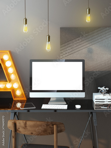 Modern workspace with computer and bulbs - 74640970