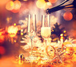 Christmas holiday decorated table. Champagne glasses