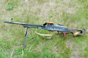 7.62mm. Kalashnikov machine gun on the grass.