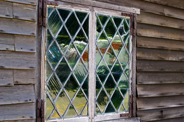 Old glass window. Plymouth, MA