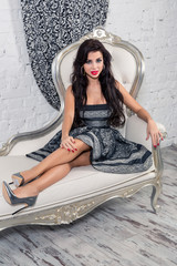 Young woman in a armchair. Retro style.