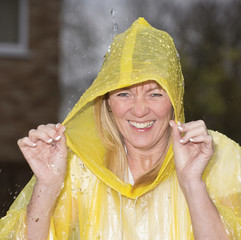 Woman wearing a yellow poncho in the rain