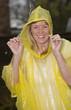 Woman wearing a yellow poncho in the rain