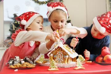 Three kids in caps decorated
